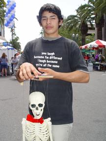 Teen at interactive display Anaheim Art Festival