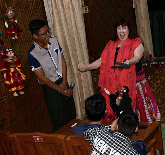 Penelope at the Mandalay Theater in Burma with her marionette of Ravana