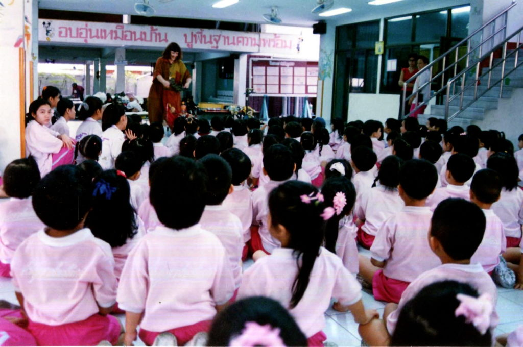Penelope performing at a Thialand School